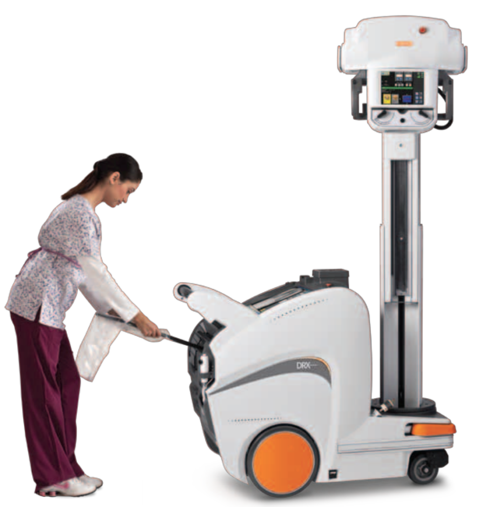 A woman wearing scrubs pushes a large, wheeled portable X-ray machine. Portable X-ray machines offer a number of benefits that increase patient care.