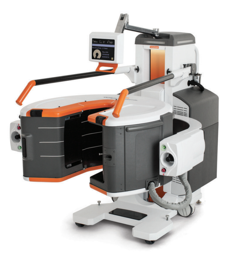 Pictured is an EOS X-ray machine against a white background. The machine is fitted for taking full body scans.