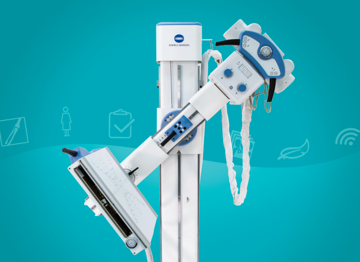 A free-standing X-ray machine is pictured against a light blue background. Leasing medical equipment could be the best option for your medical facility.