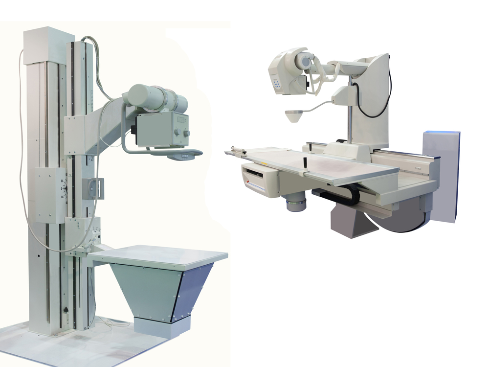 A 3D X-ray apparatus, comprised of 2 machines, is pictured against a white background.